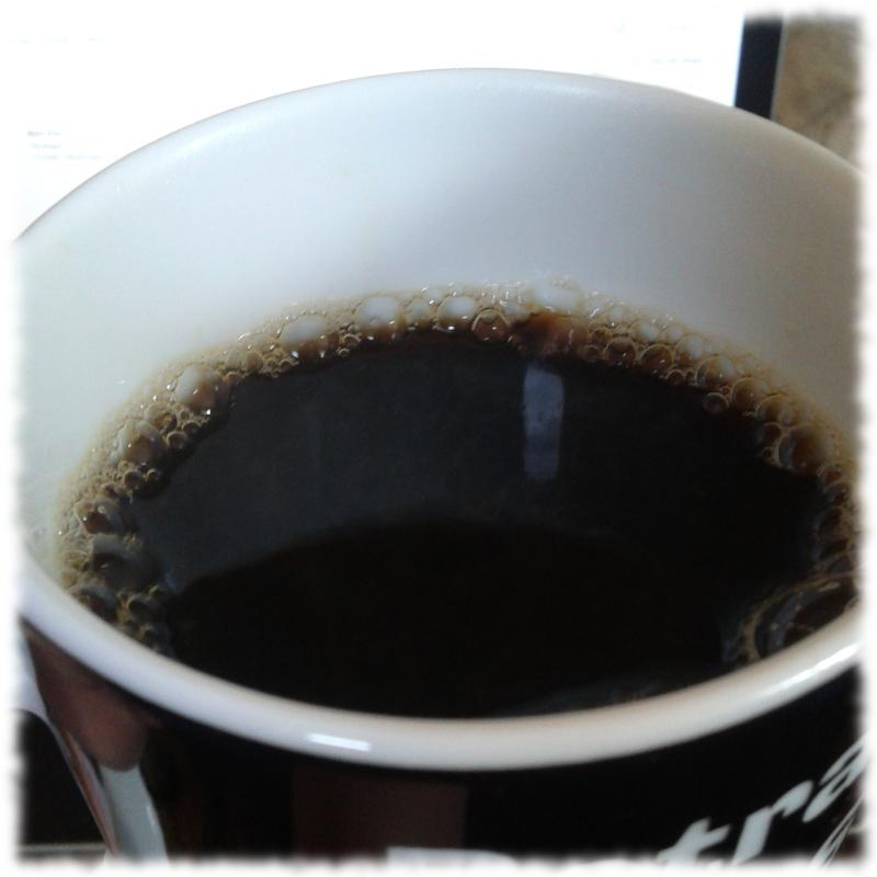 Tasse mit Kaffee drin.